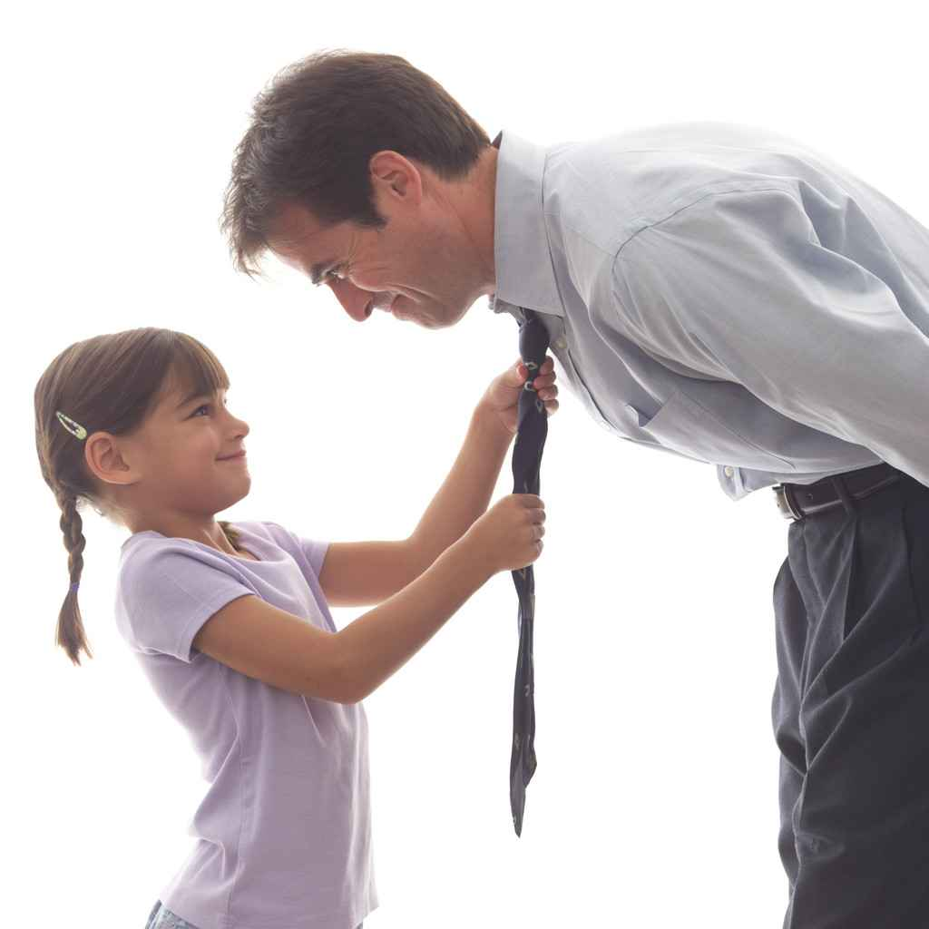Little Girl Helping Father with His Tie